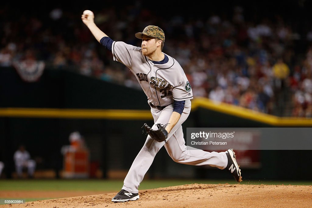 Starting pitcher <a gi-track='captionPersonalityLinkClicked' href=/galleries/search?phrase=Collin+McHugh&family=editorial&specificpeople=9660247 ng-click='$event.stopPropagation()'>Collin McHugh</a> #31 of the Houston Astros pitches against the Arizona Diamondbacks during the first inning of the MLB game at Chase Field on May 30, 2016 in Phoenix, Arizona.