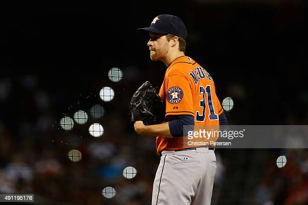 Starting pitcher Collin McHugh of the Houston Astros prepares to pitches against the Arizona Diamondbacks during the MLB game at Chase Field on...