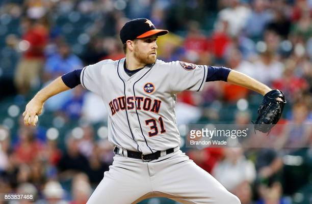 Starting pitcher Collin McHugh of the Houston Astros throws during the first inning of a baseball game against the Texas Rangers at Globe Life Park...