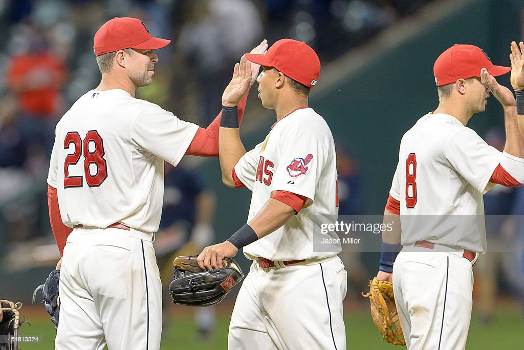 Starting pitcher Corey Kluber #28 celebrates with Michael Brantley #23 of the Cleveland Indians after the Indians defeated the Chicago White Sox at Progressive Field on September 6, 2014 in Cleveland, Ohio. The Indians defeated the White Sox 3-1.