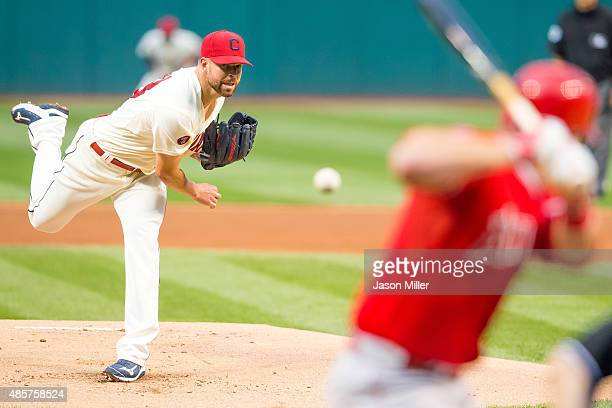 Starting pitcher Corey Kluber of the Cleveland Indians pitches to Mike Trout of the Los Angeles Angels of Anaheim during the first inning against the...