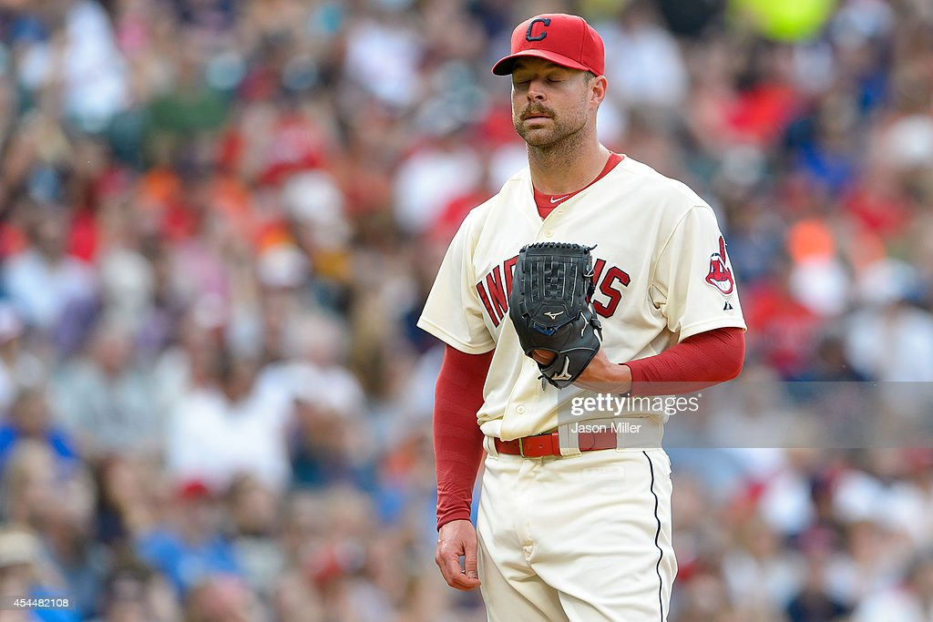 Starting pitcher <a gi-track='captionPersonalityLinkClicked' href=/galleries/search?phrase=Corey+Kluber&family=editorial&specificpeople=7513243 ng-click='$event.stopPropagation()'>Corey Kluber</a> #28 of the Cleveland Indians reacts after giving up back-to-back home runs during the third inning against the Detroit Tigers a Progressive Field on September 1, 2014 in Cleveland, Ohio.