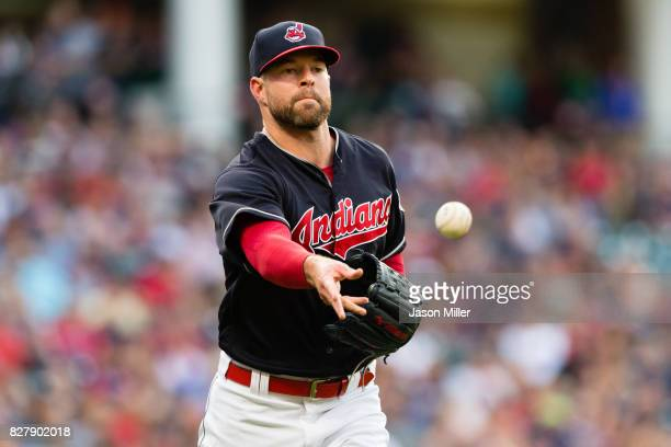 Starting pitcher Corey Kluber of the Cleveland Indians throws out Charlie Blackmon of the Colorado Rockies at first to end the top of the third...