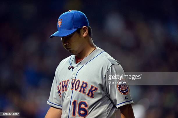 Starting pitcher Daisuke Matsuzaka of the New York Mets walks off the field after he was relieved during the fifth inning against the Chicago Cubs at...