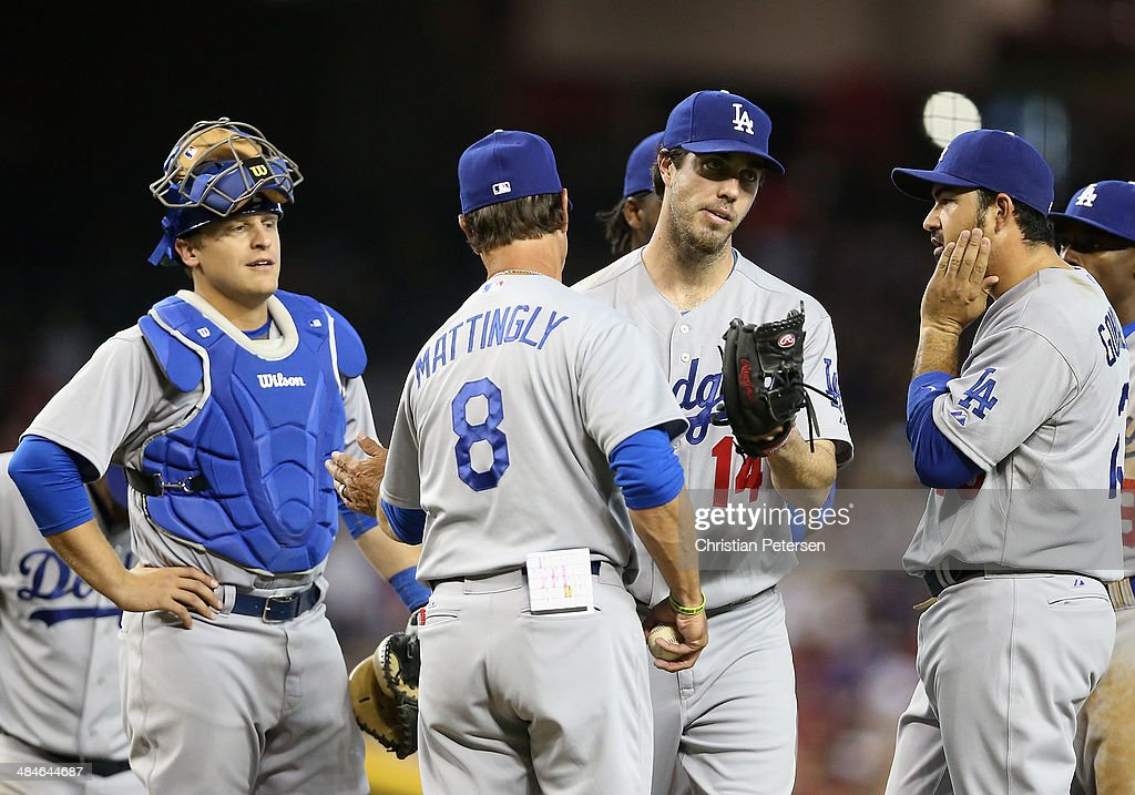 Starting pitcher <a gi-track='captionPersonalityLinkClicked' href=/galleries/search?phrase=Dan+Haren&family=editorial&specificpeople=228587 ng-click='$event.stopPropagation()'>Dan Haren</a> #14 of the Los Angeles Dodgers reacts as he is removed by manager <a gi-track='captionPersonalityLinkClicked' href=/galleries/search?phrase=Don+Mattingly&family=editorial&specificpeople=204707 ng-click='$event.stopPropagation()'>Don Mattingly</a> #8 during the sixth inning of the MLB game against the Arizona Diamondbacks at Chase Field on April 13, 2014 in Phoenix, Arizona.
