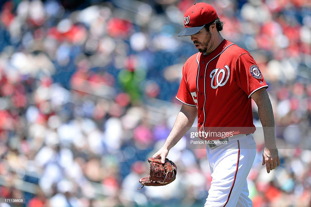 Starting pitcher <a gi-track='captionPersonalityLinkClicked' href=/galleries/search?phrase=Dan+Haren&family=editorial&specificpeople=228587 ng-click='$event.stopPropagation()'>Dan Haren</a> #15 of the Washington Nationals walks off the field after being pulled in the fourth inning during a game against the Colorado Rockies at Nationals Park on June 22, 2013 in Washington, DC.