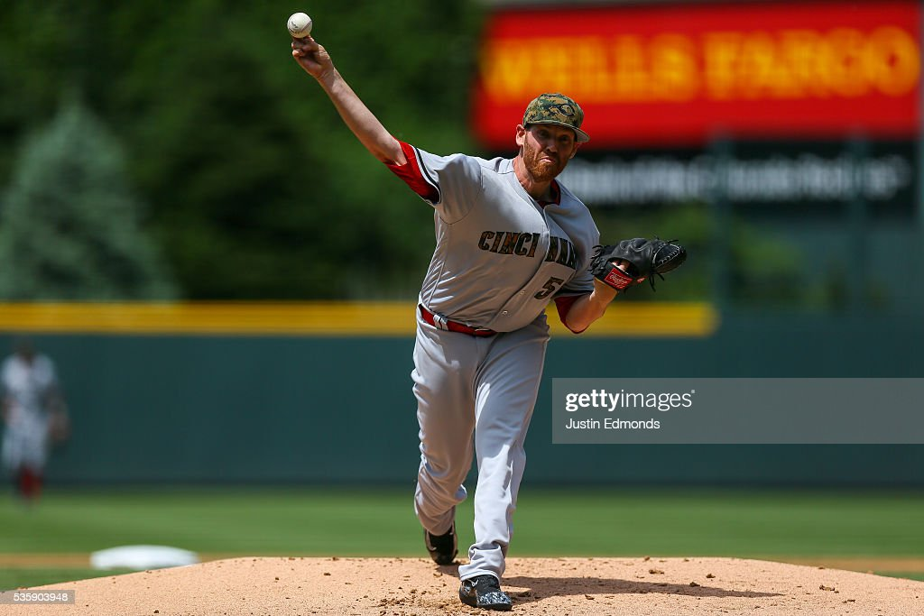 Starting pitcher <a gi-track='captionPersonalityLinkClicked' href=/galleries/search?phrase=Dan+Straily&family=editorial&specificpeople=9615114 ng-click='$event.stopPropagation()'>Dan Straily</a> #58 of the Cincinnati Reds delivers to home plate during the first inning against the Colorado Rockies at Coors Field on May 30, 2016 in Denver, Colorado.