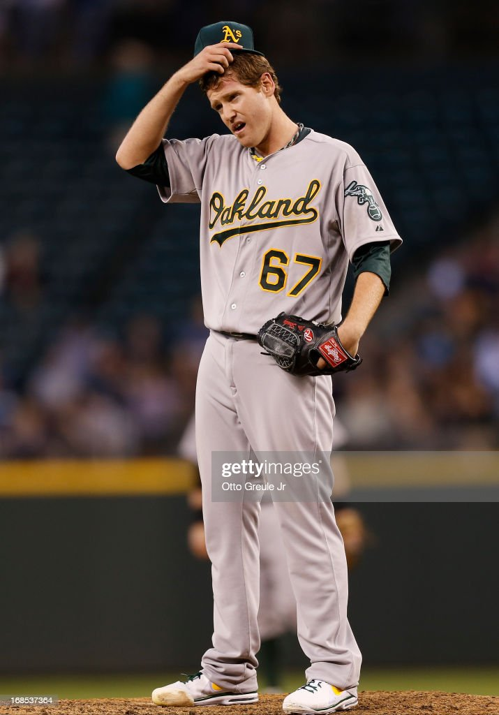 Starting pitcher <a gi-track='captionPersonalityLinkClicked' href=/galleries/search?phrase=Dan+Straily&family=editorial&specificpeople=9615114 ng-click='$event.stopPropagation()'>Dan Straily</a> #67 of the Oakland Athletics pauses after falling behind 5-0 in the fifth inning against the Seattle Mariners at Safeco Field on May 10, 2013 in Seattle, Washington. The Mariners defeated the Athletics 6-3.