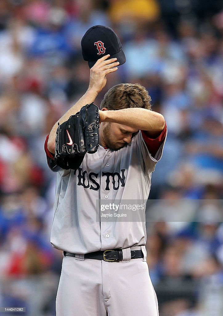Starting pitcher <a gi-track='captionPersonalityLinkClicked' href=/galleries/search?phrase=Daniel+Bard&family=editorial&specificpeople=550283 ng-click='$event.stopPropagation()'>Daniel Bard</a> #51 of the Boston Red Sox reacts after a run scores on the first of two balks during the 2nd inning of the game against the Kansas City Royals on May 8, 2012 at Kauffman Stadium in Kansas City, Missouri.