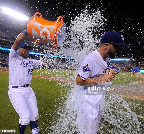 Starting pitcher Danny Duffy of the Kansas City Royals is doused with water by Salvador Perez after Duffy threw a complete game 21 win against the...