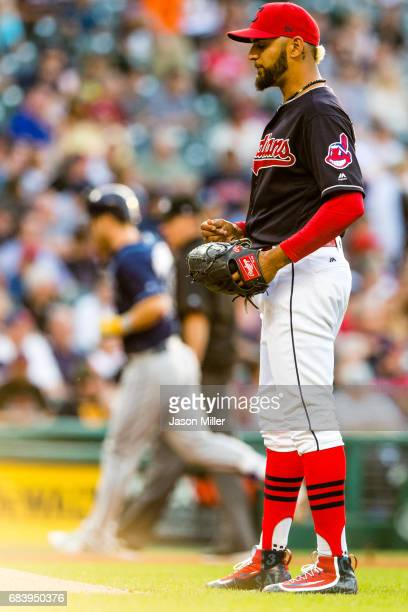 Starting pitcher Danny Salazar of the Cleveland Indians reacts as Corey Dickerson of the Tampa Bay Rays rounds the bases after hitting a home run...