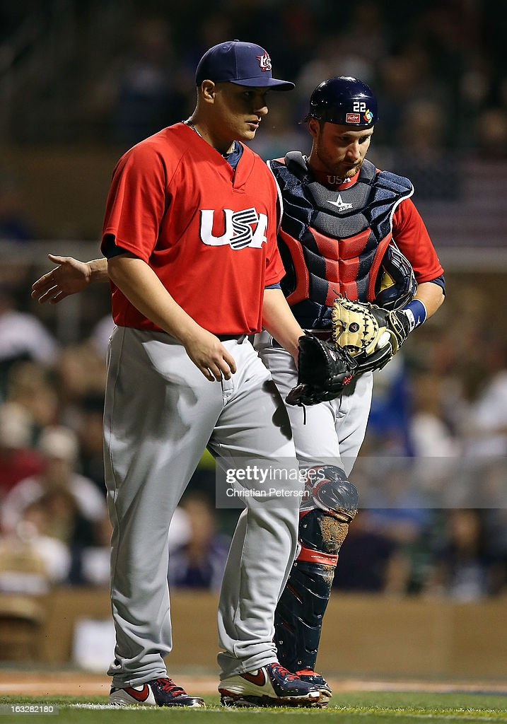 Starting pitcher David Hernandez #26 of Team USA talks with catcher <a gi-track='captionPersonalityLinkClicked' href=/galleries/search?phrase=Jonathan+Lucroy&family=editorial&specificpeople=5732413 ng-click='$event.stopPropagation()'>Jonathan Lucroy</a> #22 during the spring training game against the Colorado Rockies at Salt River Fields at Talking Stick on March 6, 2013 in Scottsdale, Arizona.