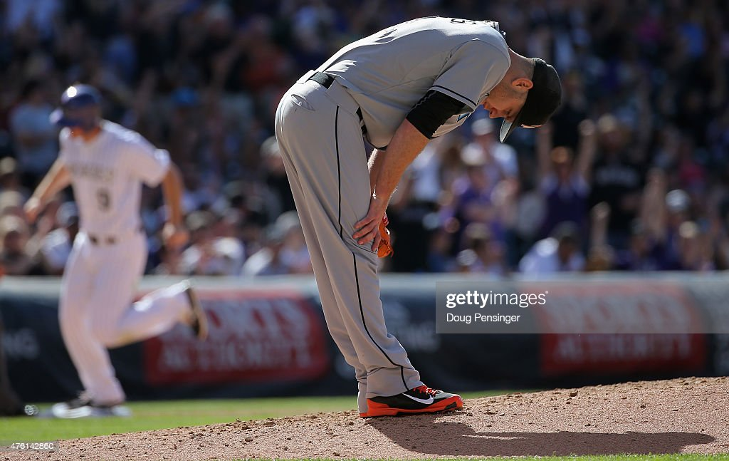 Starting pitcher <a gi-track='captionPersonalityLinkClicked' href=/galleries/search?phrase=David+Phelps+-+Baseball+Player&family=editorial&specificpeople=12583444 ng-click='$event.stopPropagation()'>David Phelps</a> #41 of the Miami Marlins reacts after giving up a three run home run to Carlos Gonzalez #5 of the Colorado Rockies as <a gi-track='captionPersonalityLinkClicked' href=/galleries/search?phrase=DJ+LeMahieu&family=editorial&specificpeople=5940806 ng-click='$event.stopPropagation()'>DJ LeMahieu</a> #9 of the Colorado Rockies rounds the bases to give the Rockies a 9-2 lead in the fourth inning at Coors Field on June 6, 2015 in Denver, Colorado.