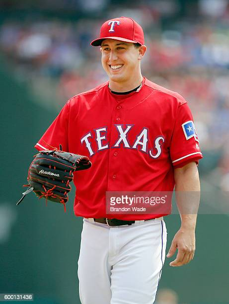 Starting pitcher Derek Holland of the Texas Rangers looks on during a baseball game against the Houston Astros at Globe Life Park in Arlington on...