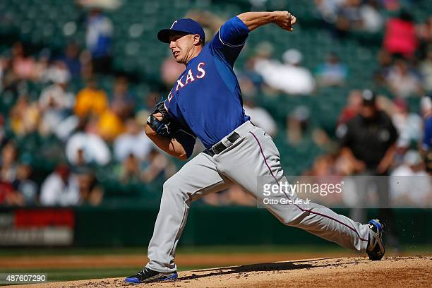 Starting pitcher Derek Holland of the Texas Rangers pitches against the Seattle Mariners in the first inning at Safeco Field on September 10 2015 in...