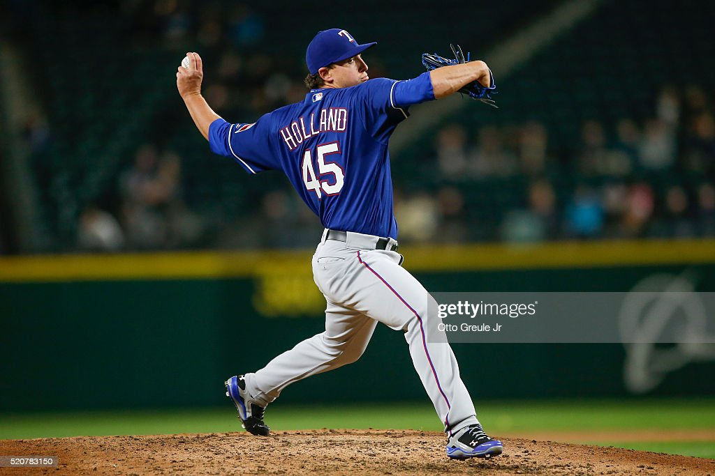Starting pitcher <a gi-track='captionPersonalityLinkClicked' href=/galleries/search?phrase=Derek+Holland+-+Baseball+Player&family=editorial&specificpeople=8003703 ng-click='$event.stopPropagation()'>Derek Holland</a> #45 of the Texas Rangers pitches against the Seattle Mariners in the fifth inning at Safeco Field on April 12, 2016 in Seattle, Washington.