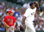 Starting pitcher Dontrelle Willis of Team USA reacts after giving up a triple to Stubby Clapp of Team Canada during the Round 1 Pool B Game of the...