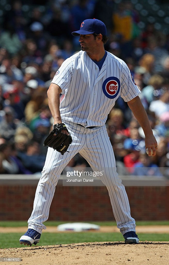 Starting pitcher <a gi-track='captionPersonalityLinkClicked' href=/galleries/search?phrase=Doug+Davis+-+Baseball+Pitcher&family=editorial&specificpeople=15809391 ng-click='$event.stopPropagation()'>Doug Davis</a> #32 of the Chicago Cubs delivers the ball against the Pittsburgh Pirates at Wrigley Field on May 27, 2011 in Chicago, Illinois.