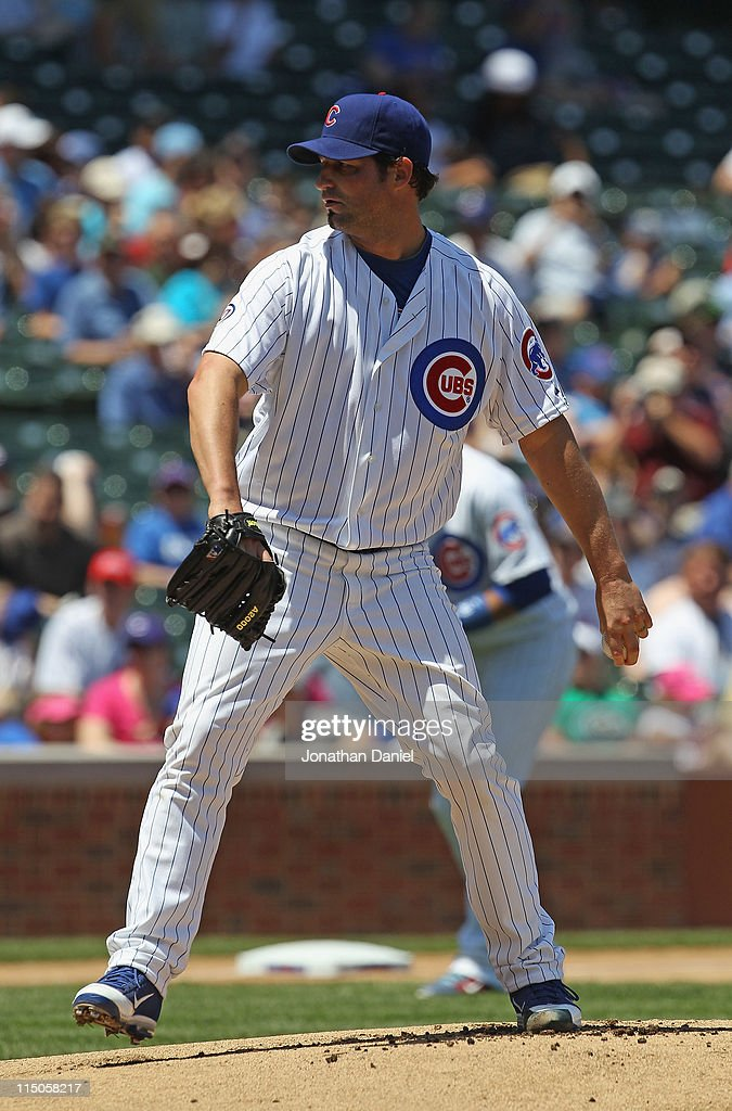 Starting pitcher <a gi-track='captionPersonalityLinkClicked' href=/galleries/search?phrase=Doug+Davis+-+Baseball+Pitcher&family=editorial&specificpeople=15809391 ng-click='$event.stopPropagation()'>Doug Davis</a> #32 of the Chicago Cubs delivers the ball against the Houston Astros at Wrigley Field on June 1, 2011 in Chicago, Illinois. The Astros defeated the Cubs 3-1.