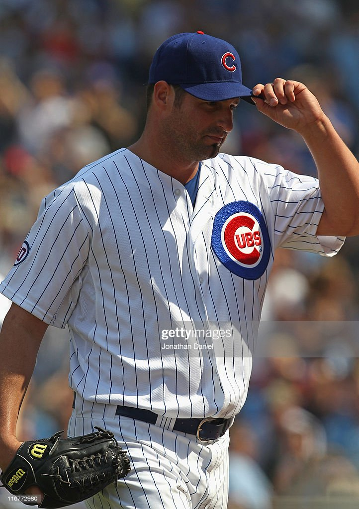 Starting pitcher <a gi-track='captionPersonalityLinkClicked' href=/galleries/search?phrase=Doug+Davis&family=editorial&specificpeople=211598 ng-click='$event.stopPropagation()'>Doug Davis</a> #32 of the Chicago Cubs tips his hat to the crowd after being taken out of a game against the New York Yankees in the 8th inning at Wrigley Field on June 17, 2011 in Chicago, Illinois. The Cubs defeated the Yankees 3-1.