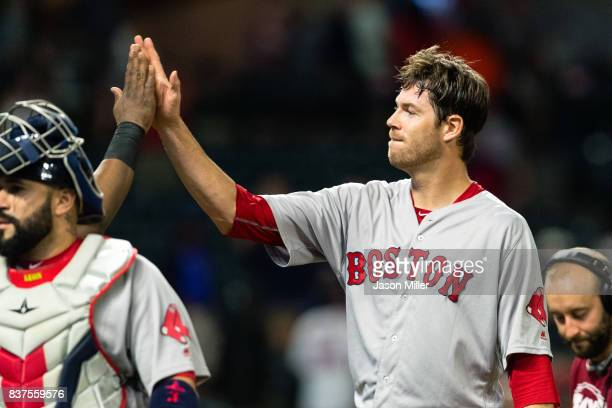 Starting pitcher Doug Fister of the Boston Red Sox celebrates with a teammate after allowing only one hit against the Cleveland Indians at...