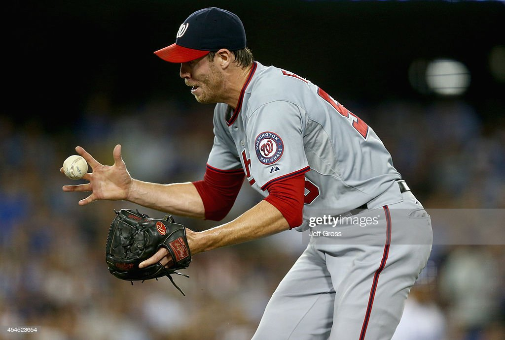 Starting pitcher <a gi-track='captionPersonalityLinkClicked' href=/galleries/search?phrase=Doug+Fister&family=editorial&specificpeople=6144840 ng-click='$event.stopPropagation()'>Doug Fister</a> #58 of the Washington Nationals loses control of the ball on a bunt by Carl Crawford of the Los Angeles Dodgers in the fourth inning at Dodger Stadium on September 2, 2014 in Los Angeles, California.