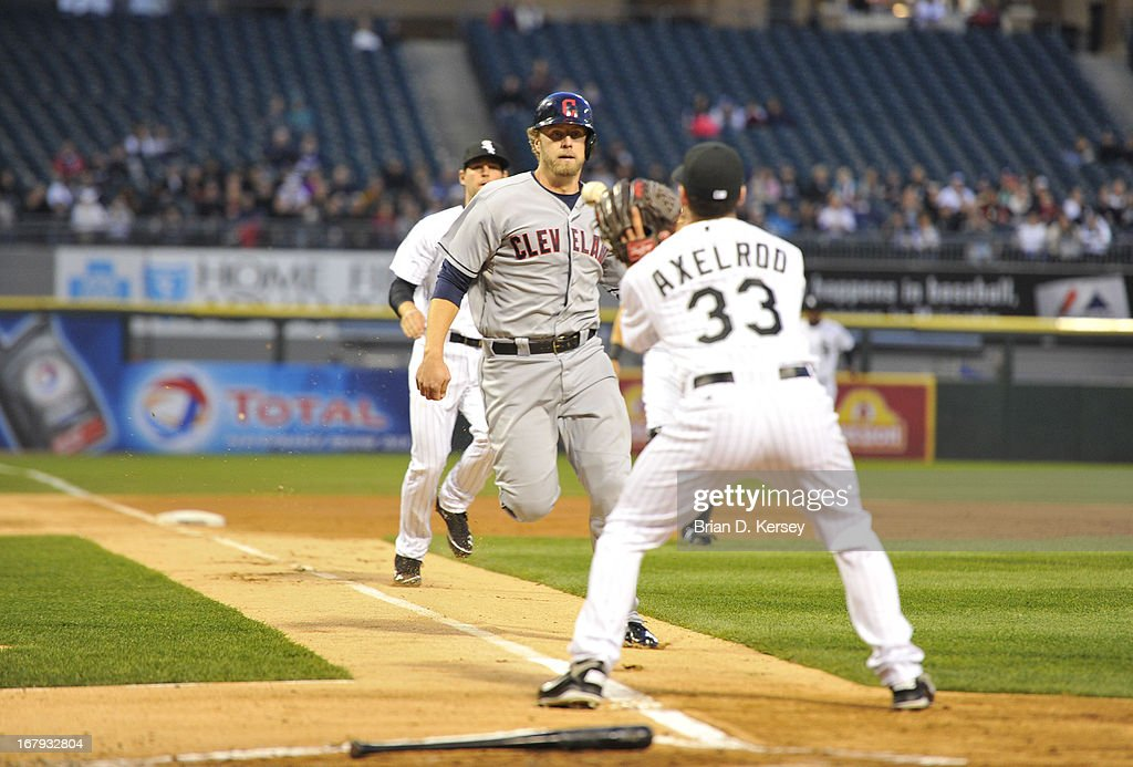 Starting pitcher Dylan Axelrod #33 of the Chicago White Sox (R) gets ready to tag out Mark Reynolds #12 of the Cleveland Indians at home plate after Drew Stubbs #11 hit into a fielder's choice during the second inning on April 22, 2013 at U.S. Cellular Field in Chicago, Illinois.