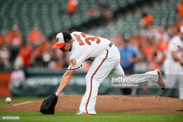 Starting pitcher Dylan Bundy of the Baltimore Orioles is unable to field a ground ball hit by Lorenzo Cain of the Kansas City Royals in the first...
