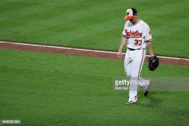Starting pitcher Dylan Bundy of the Baltimore Orioles leaves the game in the fifth inning against the Boston Red Sox at Oriole Park at Camden Yards...