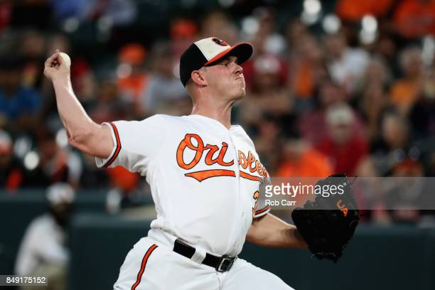 Starting pitcher Dylan Bundy of the Baltimore Orioles throws to a Boston Red Sox batter in the first inning at Oriole Park at Camden Yards on...
