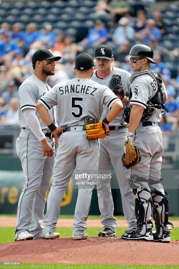 Starting pitcher Dylan Covey #68 of the Chicago White Sox is talked to on a mound conference during the 1st inning of the game against the Kansas City Royals at Kauffman Stadium on September 12, 2017 in Kansas City, Missouri.