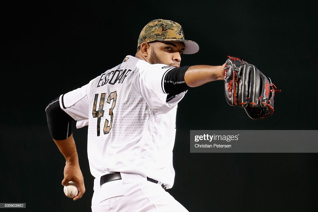 Starting pitcher Edwin Escobar #43 of the Arizona Diamondbacks throws a warm up pitch before the start of the MLB game against the Houston Astros at Chase Field on May 30, 2016 in Phoenix, Arizona.