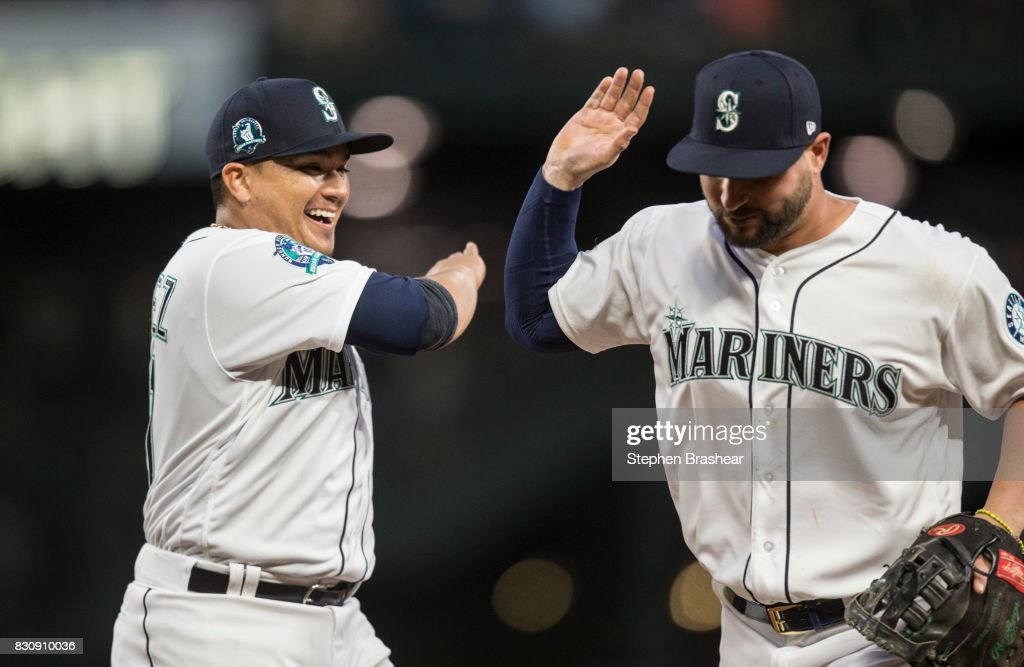 Starting pitcher Erasmo Ramirez #31, left, of the Seattle Mariners celebrates after first baseman Yonder Alonso #10 of the Seattle Mariners made the final out of the sixth inning during a game at Safeco Field on August 12, 2017 in Seattle, Washington.