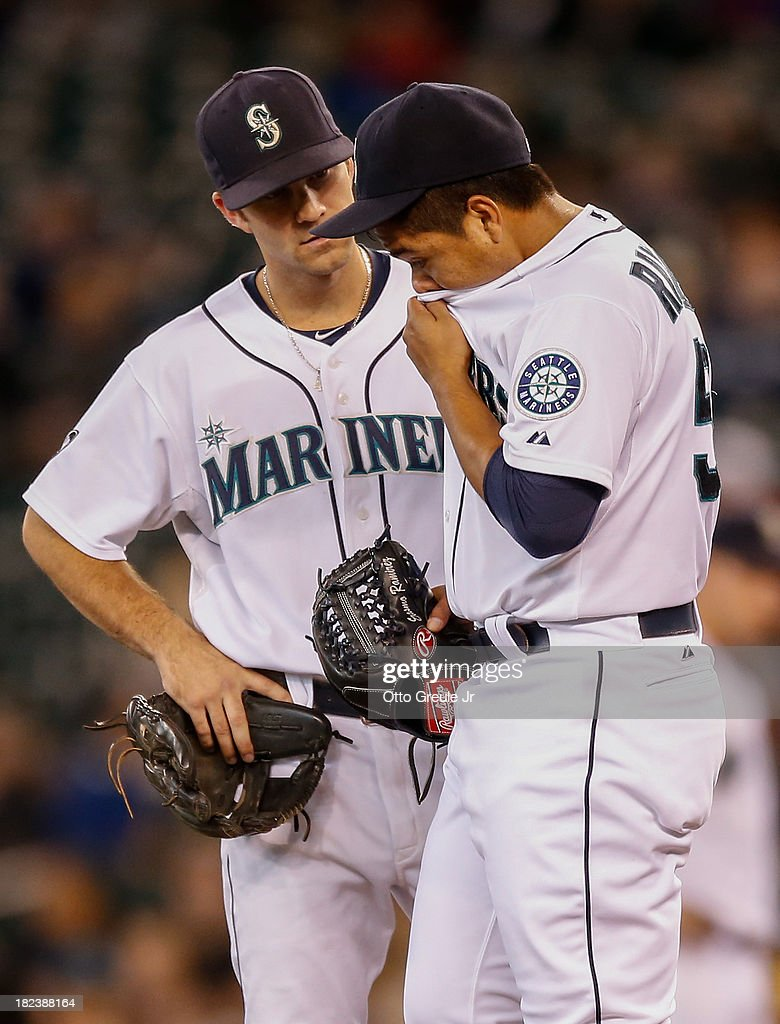 Starting pitcher <a gi-track='captionPersonalityLinkClicked' href=/galleries/search?phrase=Erasmo+Ramirez&family=editorial&specificpeople=234687 ng-click='$event.stopPropagation()'>Erasmo Ramirez</a> #50 of the Seattle Mariners gets a visit from second baseman <a gi-track='captionPersonalityLinkClicked' href=/galleries/search?phrase=Nick+Franklin&family=editorial&specificpeople=3092191 ng-click='$event.stopPropagation()'>Nick Franklin</a> #20 in the second inning against the Oakland Athletics at Safeco Field on September 29, 2013 in Seattle, Washington.