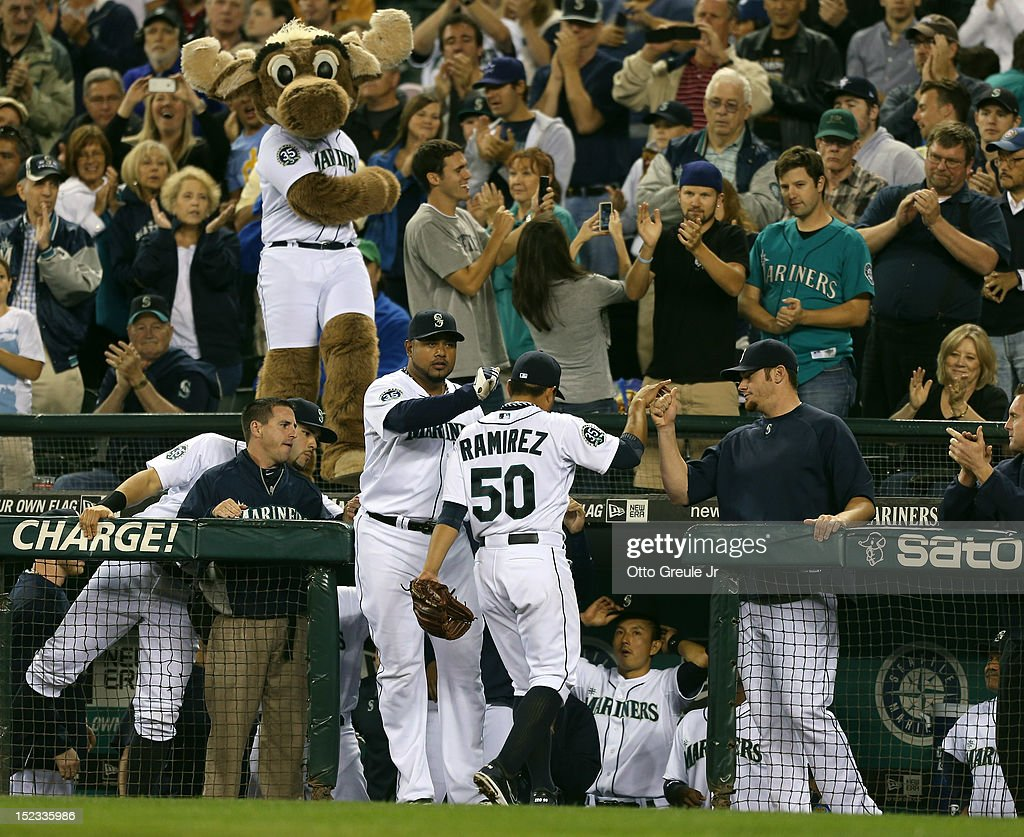 Starting pitcher <a gi-track='captionPersonalityLinkClicked' href=/galleries/search?phrase=Erasmo+Ramirez&family=editorial&specificpeople=234687 ng-click='$event.stopPropagation()'>Erasmo Ramirez</a> #50 of the Seattle Mariners is congratulated as he comes out of the game in the ninth inning against the Baltimore Orioles at Safeco Field on September 18, 2012 in Seattle, Washington.