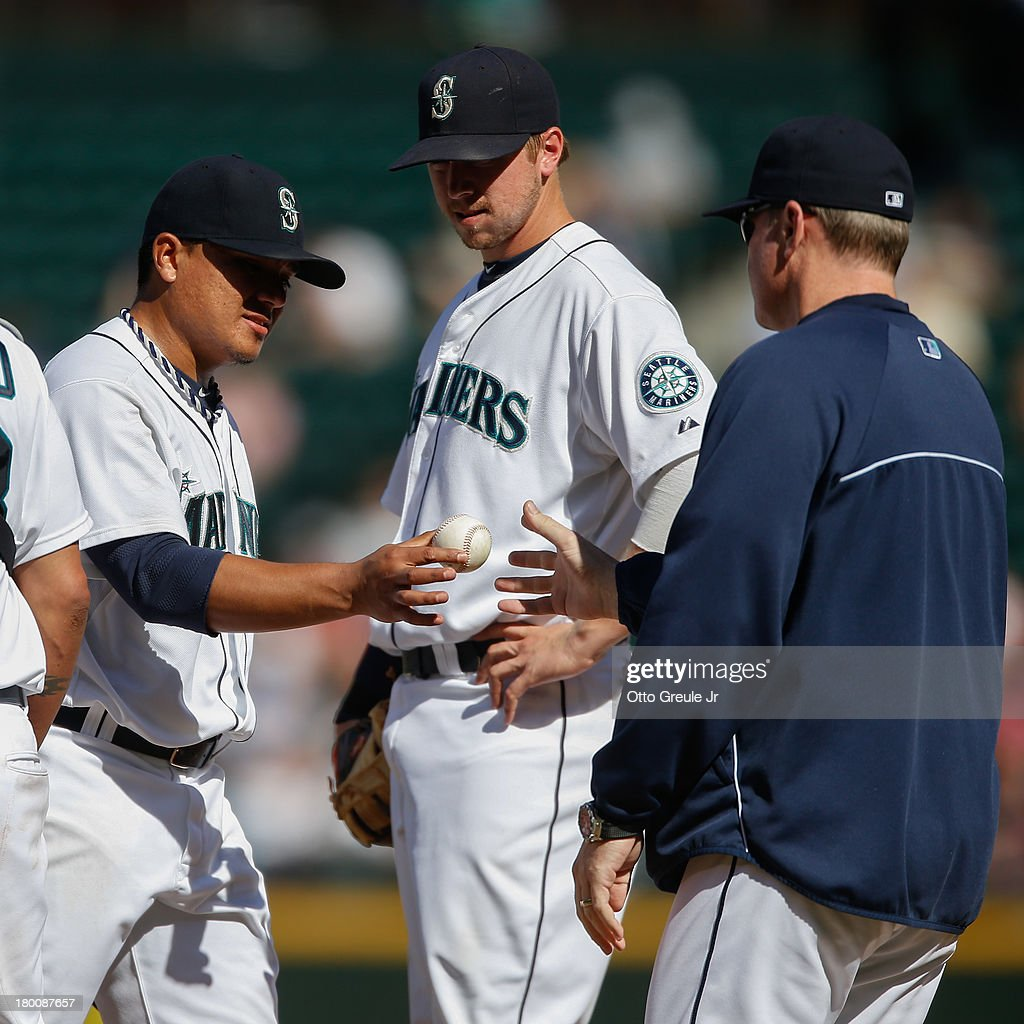 Starting pitcher <a gi-track='captionPersonalityLinkClicked' href=/galleries/search?phrase=Erasmo+Ramirez&family=editorial&specificpeople=234687 ng-click='$event.stopPropagation()'>Erasmo Ramirez</a> #50 of the Seattle Mariners is removed from the game by manager <a gi-track='captionPersonalityLinkClicked' href=/galleries/search?phrase=Eric+Wedge&family=editorial&specificpeople=214257 ng-click='$event.stopPropagation()'>Eric Wedge</a> #22 in the seventh inning against the Tampa Bay Rays at Safeco Field on September 8, 2013 in Seattle, Washington. The Rays defeated the Mariners 4-1.