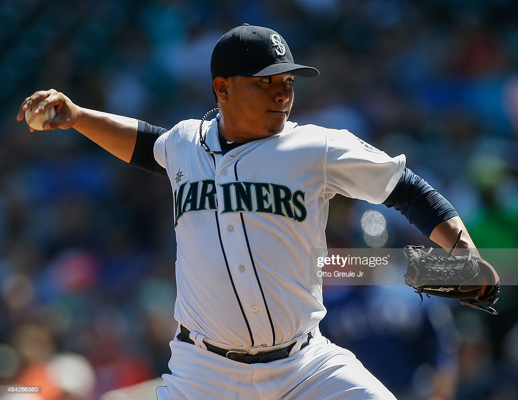 Starting pitcher Erasmo Ramirez #50 of the Seattle Mariners pitches in the first inning against the Texas Rangers at Safeco Field on August 27, 2014 in Seattle, Washington. The Rangers defeated the Mariners 12-4.