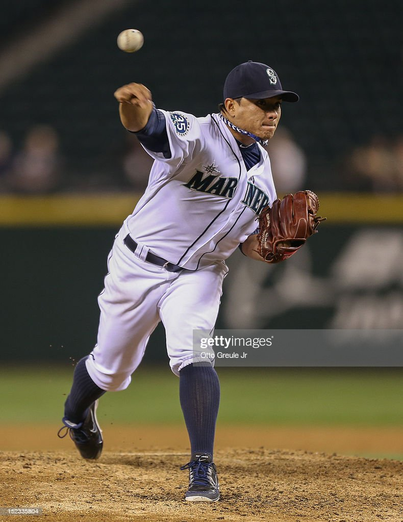 Starting pitcher <a gi-track='captionPersonalityLinkClicked' href=/galleries/search?phrase=Erasmo+Ramirez&family=editorial&specificpeople=234687 ng-click='$event.stopPropagation()'>Erasmo Ramirez</a> #50 of the Seattle Mariners pitches against the Baltimore Orioles at Safeco Field on September 18, 2012 in Seattle, Washington.