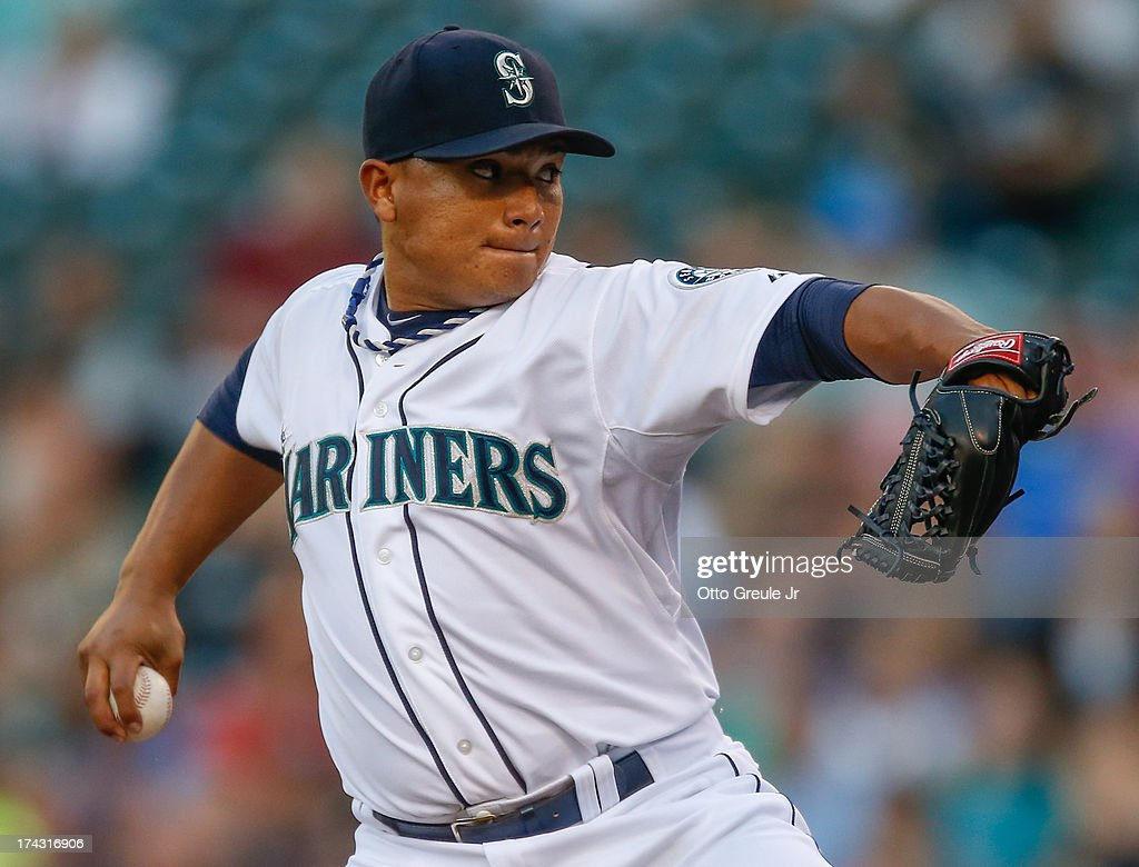 Starting pitcher <a gi-track='captionPersonalityLinkClicked' href=/galleries/search?phrase=Erasmo+Ramirez&family=editorial&specificpeople=234687 ng-click='$event.stopPropagation()'>Erasmo Ramirez</a> #50 of the Seattle Mariners pitches against the Cleveland Indians at Safeco Field on July 23, 2013 in Seattle, Washington.