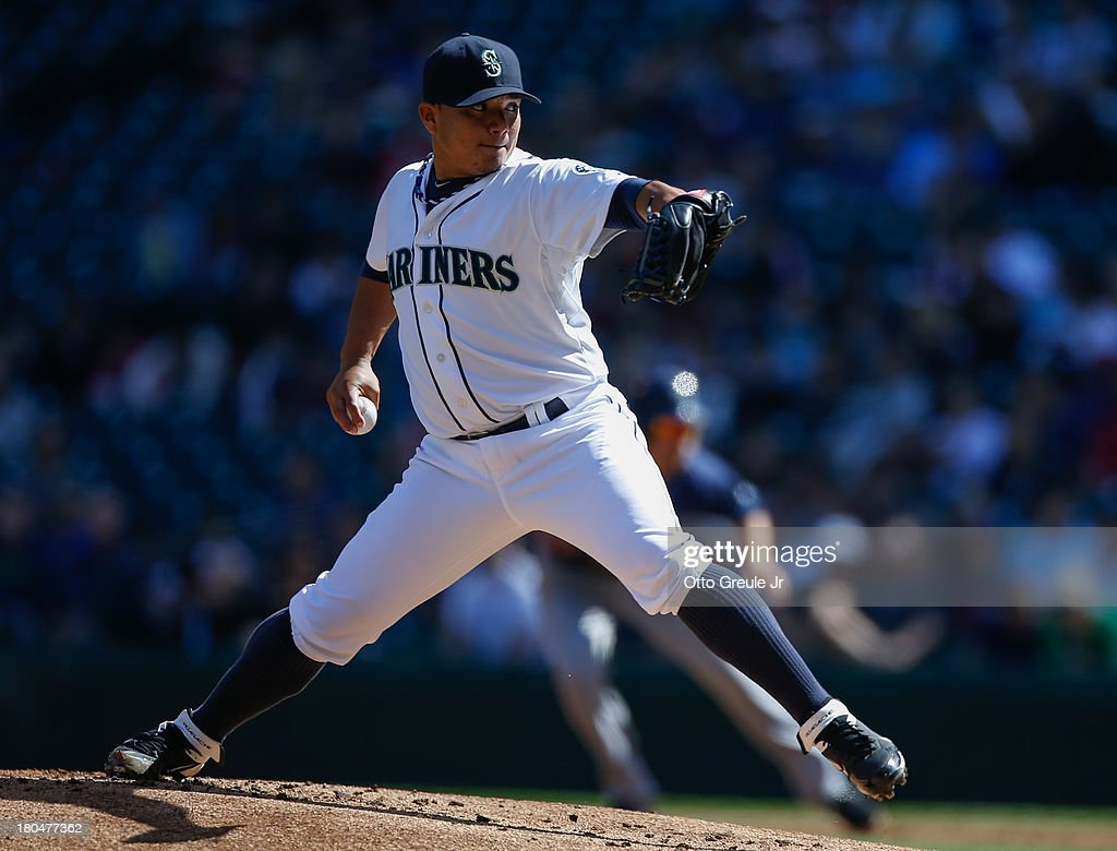 Starting pitcher <a gi-track='captionPersonalityLinkClicked' href=/galleries/search?phrase=Erasmo+Ramirez&family=editorial&specificpeople=234687 ng-click='$event.stopPropagation()'>Erasmo Ramirez</a> #50 of the Seattle Mariners pitches against the Tampa Bay Rays at Safeco Field on September 8, 2013 in Seattle, Washington.