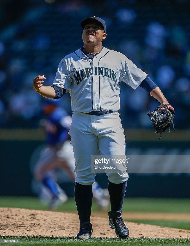 Starting pitcher Erasmo Ramirez #50 of the Seattle Mariners reacts after giving up a grand slam to Rougned Odor of the Texas Rangers in the third inning at Safeco Field on August 27, 2014 in Seattle, Washington. The Rangers defeated the Mariners 12-4.