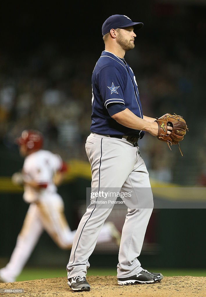 Starting pitcher Eric Stults #53 of the San Diego Padres reacts after giving up a three-run home run to A.J. Pollock #11 of the Arizona Diamondbacks during the fifth inning of the MLB game at Chase Field on September 12, 2014 in Phoenix, Arizona.