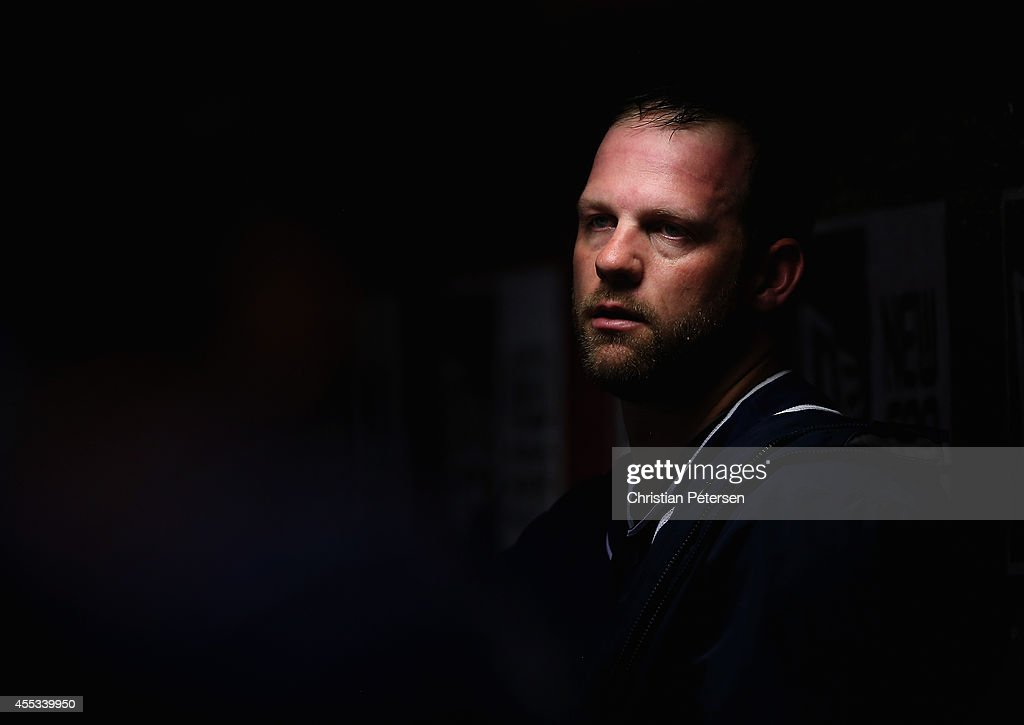 Starting pitcher Eric Stults #53 of the San Diego Padres watches from the dugout during the MLB game against the Arizona Diamondbacks at Chase Field on September 12, 2014 in Phoenix, Arizona.