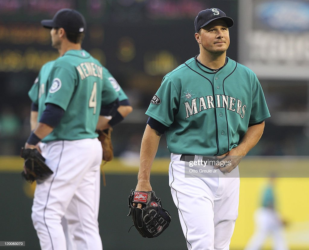 Starting pitcher Erik Bedard #45 of the Seattle Mariners heads off the mound after being removed from the game in the second inning by manager Eric Wedge against the Tampa Bay Rays at Safeco Field on July 29, 2011 in Seattle, Washington.