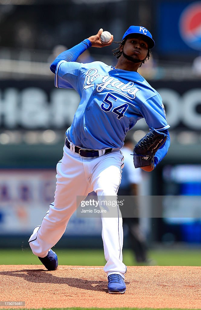 Starting pitcher <a gi-track='captionPersonalityLinkClicked' href=/galleries/search?phrase=Ervin+Santana&family=editorial&specificpeople=243096 ng-click='$event.stopPropagation()'>Ervin Santana</a> #54 of the Kansas City Royals warms up prior to the start of the game against the Oakland Athletics at Kauffman Stadium on July 6, 2013 in Kansas City, Missouri.