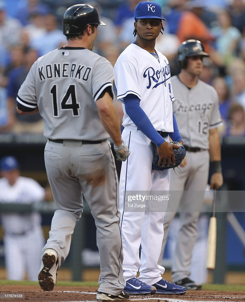 Starting pitcher <a gi-track='captionPersonalityLinkClicked' href=/galleries/search?phrase=Ervin+Santana&family=editorial&specificpeople=243096 ng-click='$event.stopPropagation()'>Ervin Santana</a> #54 of the Kansas City Royals watches <a gi-track='captionPersonalityLinkClicked' href=/galleries/search?phrase=Paul+Konerko&family=editorial&specificpeople=203327 ng-click='$event.stopPropagation()'>Paul Konerko</a> #14 of the Chicago White Sox cross home to score on a passed ball in the second inning at Kauffman Stadium August 20, 2013 in Kansas City, Missouri.