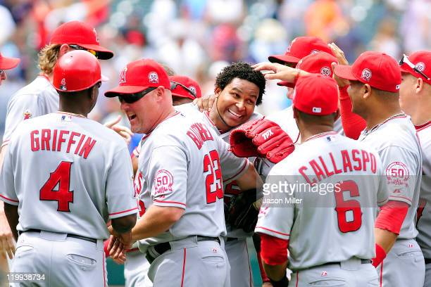 Starting pitcher Ervin Santana of the Los Angeles Angels celebrates with his teammates after throwing a nohitter against the Cleveland Indians at...