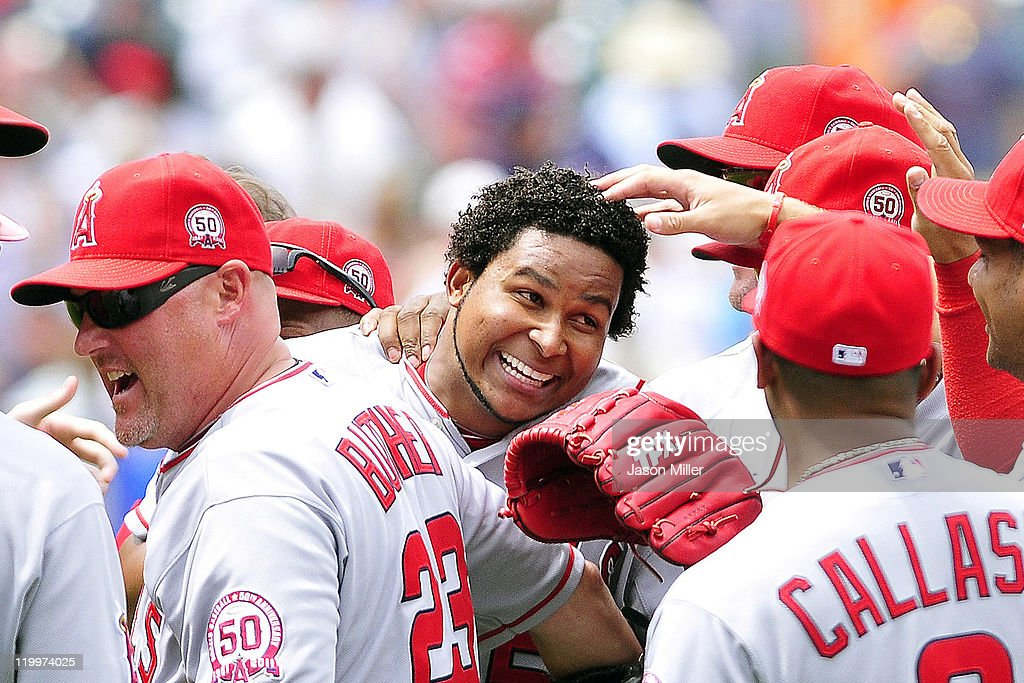 Starting pitcher <a gi-track='captionPersonalityLinkClicked' href=/galleries/search?phrase=Ervin+Santana&family=editorial&specificpeople=243096 ng-click='$event.stopPropagation()'>Ervin Santana</a> #54 of the Los Angeles Angels of Anaheim celebrates with his teammates after throwing a no-hitter against the Cleveland Indians at Progressive Field on July 27, 2011 in Cleveland, Ohio. The Angels defeated the Indians 3-1.