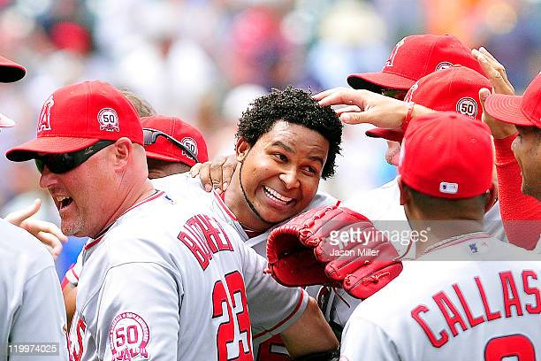 Starting pitcher Ervin Santana of the Los Angeles Angels of Anaheim celebrates with his teammates after throwing a nohitter against the Cleveland...