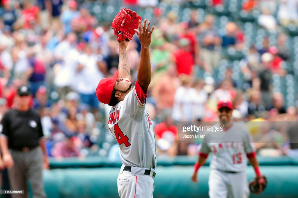Starting pitcher <a gi-track='captionPersonalityLinkClicked' href=/galleries/search?phrase=Ervin+Santana&family=editorial&specificpeople=243096 ng-click='$event.stopPropagation()'>Ervin Santana</a> #54 of the Los Angeles Angels throws up his arms in celebration after finishing a no-hitter against the Cleveland Indians on July 27, 2011 at Progressive Field in Cleveland, Ohio. The Angels defeated the Indians 3-1.